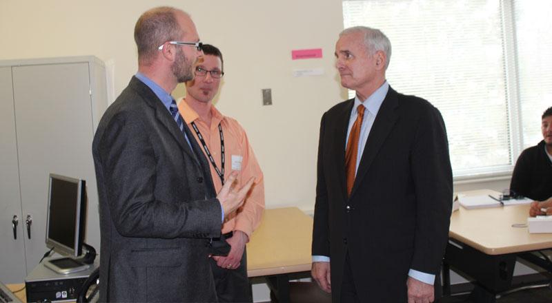 Governor Mark Dayton speaks with MentorMate CEO Björn Stansvik