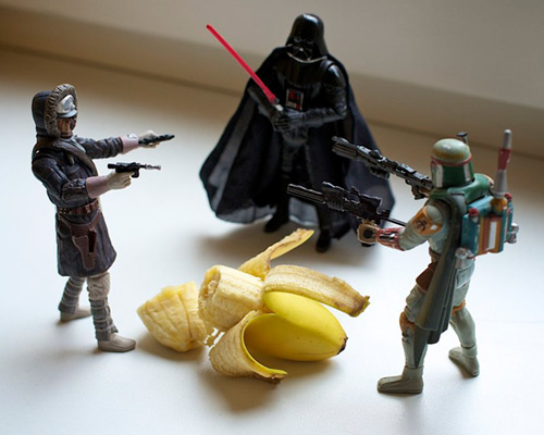 Boba Fett, Darth Vader and a Rebel soldier having a stand off over a banana