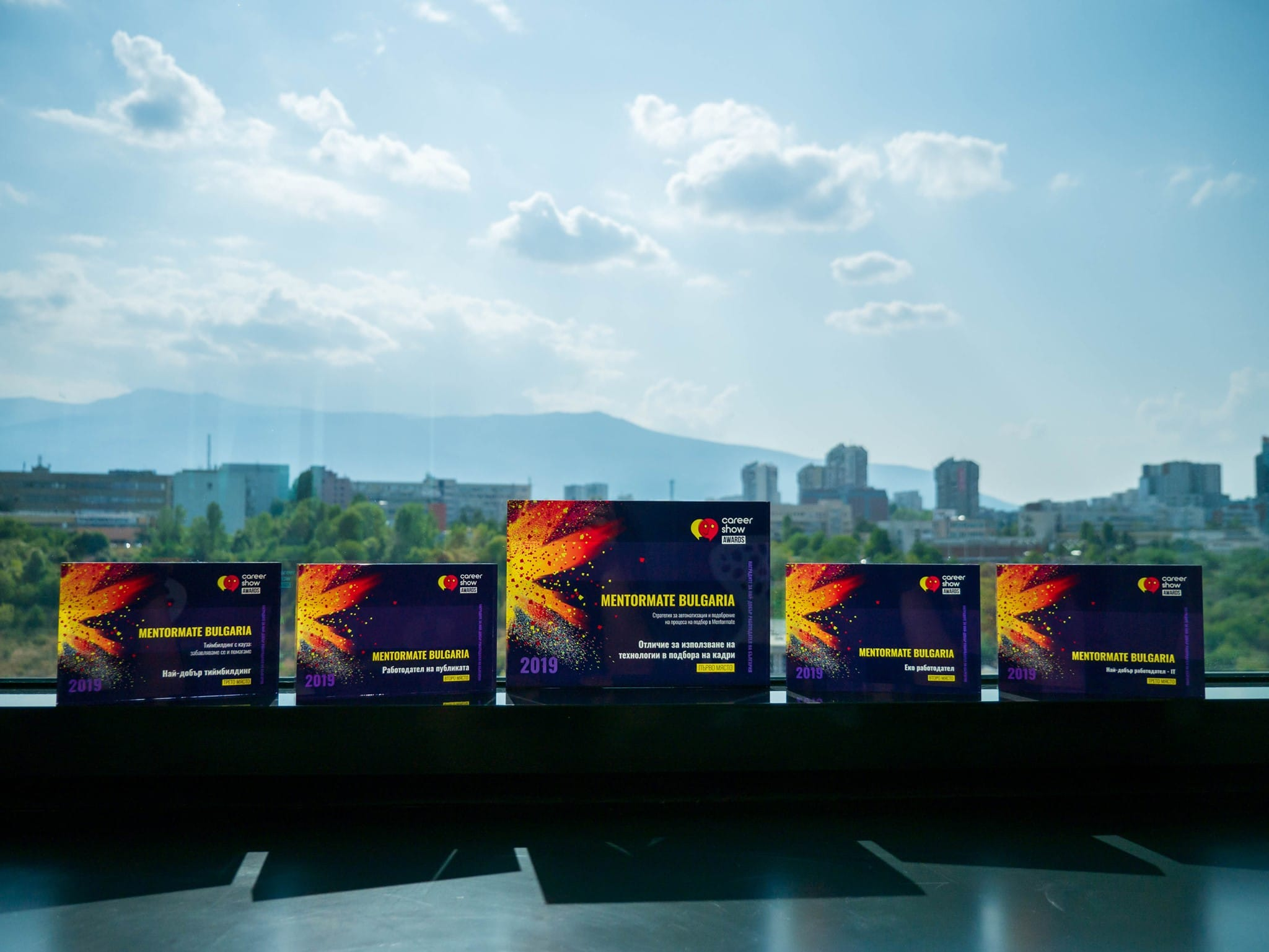 Photo of the five awards that MentorMate won in 2019 for being a top IT employer in Bulgaria